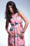 Serious youn fashion woman in long dress Stock Photos