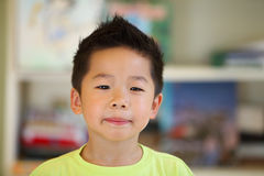 Serious young Asian boy Stock Image