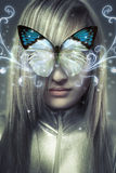 Serious young blond, concept future and modernity. Girl with butterfly Stock Photo