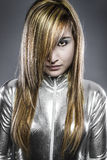 Serious young blond, concept future and modernity, girl in silve. R Stock Photos