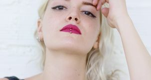 Serious young blond woman staring at the camera stock video