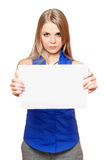 Serious young blonde holding empty white board Royalty Free Stock Photography