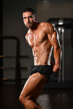 Serious Young Bodybuilder Standing In The Gym Royalty Free Stock Photo