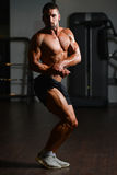 Serious Young Bodybuilder Standing In The Gym Royalty Free Stock Photography