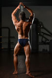 Serious Young Bodybuilder Standing In The Gym Royalty Free Stock Images