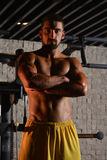 Serious Young Bodybuilder Standing In The Gym Stock Photos