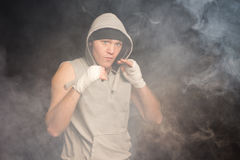 Serious young boxer spoiling for a fight Royalty Free Stock Images
