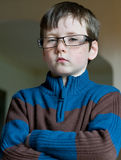 Serious young boy with glasses like businessman Royalty Free Stock Photography