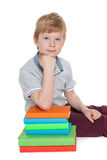Serious young boy near books Royalty Free Stock Photography