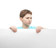 Serious young boy with a sheet of paper Stock Photography