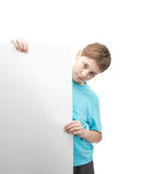 Serious young boy with a sheet of paper Royalty Free Stock Photos