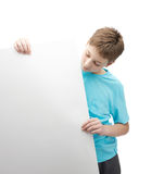 Serious young boy with a sheet of paper Royalty Free Stock Photo