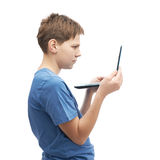 Serious young boy with a small notebook computer Royalty Free Stock Photography