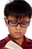 Serious young boy studying Royalty Free Stock Images