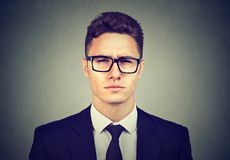 Serious young business man in glasses royalty free stock photos