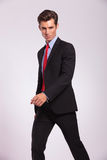 Serious young business man walking Royalty Free Stock Images