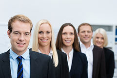 Serious young business manager with his team Stock Image