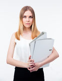 Serious young business woman holding folders Royalty Free Stock Photo
