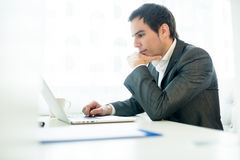 Serious young businessman concentrating on his work Royalty Free Stock Photo