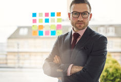 Serious young businessman with crossed arms Royalty Free Stock Image