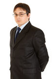 Serious young businessman with eyeglasses isolated Stock Photos