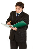 Serious young businessman holding folder in hand Royalty Free Stock Images