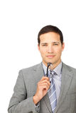 Serious young businessman holding glasses Royalty Free Stock Photos
