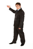Serious young businessman pointing  in corner Royalty Free Stock Photo