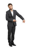 Serious young businessman pointing royalty free stock photography