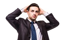 Serious young businessman standing with hands crossed isolated on white. Background Stock Photography