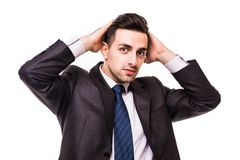 Serious young businessman standing with hands crossed isolated on white. Background Royalty Free Stock Photos