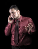 Serious young businessman talking on phone Royalty Free Stock Photography