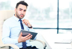 Serious young businessman Stock Images