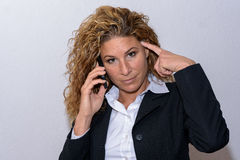 Serious young businesswoman with her mobile Royalty Free Stock Photography
