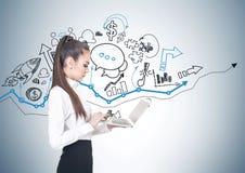 Serious young businesswoman, laptop, graphs Stock Photos