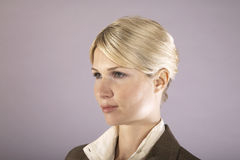 Serious Young Businesswoman Looking Away Royalty Free Stock Images