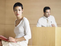 Serious Young Businesswoman In Presentation Room Stock Photo