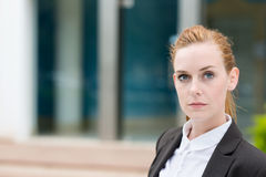Serious Young Businesswoman. Serious young redhead businesswoman looking at camera Royalty Free Stock Photo