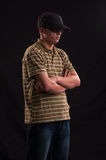 Serious young caucasian man with sunglasses and baseball hat, lo Stock Images