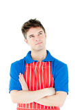 Serious young cook wearing apron with folded arms Royalty Free Stock Photo