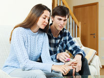 Serious young couple with pregnancy test Stock Photos
