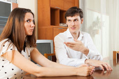 Serious young couple talking Royalty Free Stock Photos