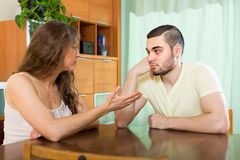 Serious young couple talking at home Stock Photography