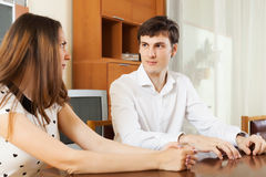 Serious young couple talking in home Stock Images