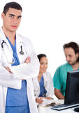 Serious young doctor looking at the camera Royalty Free Stock Photography