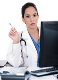 Serious young doctor looking strangely at us Stock Photo
