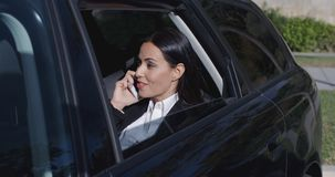 Serious young executive on phone in limousine stock video