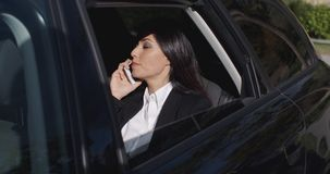 Serious young executive on phone in limousine stock footage