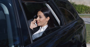 Serious young executive on phone in limousine Stock Image