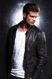 Serious young fashion model in leather jacket Stock Image